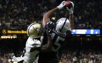 NEW ORLEANS, LA - SEPTEMBER 11:  Michael Crabtree #15 of the Oakland Raiders catches a pass over Delvin Breaux #40 of the New Orleans Saints completing a two-point conversion to take the lead late in the second half of a game at Mercedes-Benz Superdome on September 11, 2016 in New Orleans, Louisiana.  (Photo by Jonathan Bachman/Getty Images)